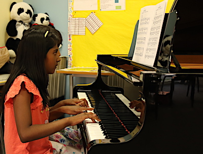 The talented Soumya and her friend trying out the new grand piano