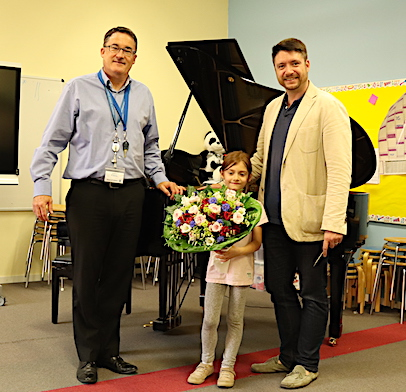 Mr. Brock of the Hamburger Staatsoper and his daughter handing over the new grand piano
