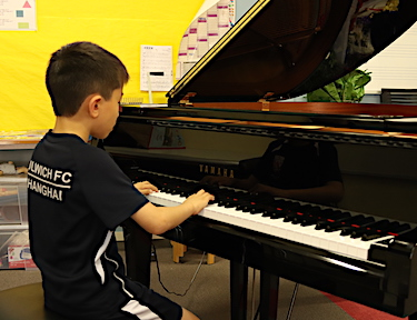 The talented Max tries out the new grand piano